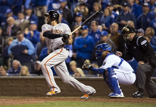 San Francisco Giants left fielder Michael Morse (38)  singles for the game winning hit scoring San Francisco Giants third baseman Pablo Sandoval (48) in the fourth inning of Game 7 of baseball's World Series against the Kansas City Royals Wednesday, Oct. 29, 2014, in Kansas City, Mo. (AP Photo/The Sacramento Bee, Paul Kitagaki Jr.)
