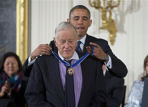 In this Nov. 20, 2013 file photo, President Barack Obama awards former Washington Post executive editor Ben Bradlee with the Presidential Medal of Freedom during a ceremony in the East Room of the White House in Washington. Bradlee died Tuesday, Oct. 21, 2014, according to the Washington Post. (AP Photo/ Evan Vucci, File)