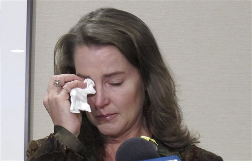 """Cylvia Hayes, fiancee of Oregon Gov. John Kitzhaber, cries as she speaks at a news conference in Portland, Ore. on Thursday, Oct. 9, 2014. Hayes has admitted that she violated the law when she married an immigrant seeking to retain residency in the United States. She said she was """"associating with the wrong people"""" while struggling to put herself through college and regrets her actions. (AP Photo/Gosia Wozniacka)"""
