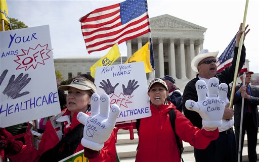 In this March 28, 2012 file photo, protesters chant in front of the Supreme Court in Washington as the court concludes three days of hearing arguments on the constitutionality of President Barack Obama's health care overhaul, the Patient Protection and Affordable Care Act. Supreme Court justices have their first chance this week to decide whether they have the appetite for another major fight over President Barack Obama's health care law. Some of the same players who mounted the first failed effort to kill the law altogether now want the justices to rule that subsidies that help millions of low- and middle-income people afford their premiums under the law are illegal. (AP Photo/Carolyn Kaster, File)