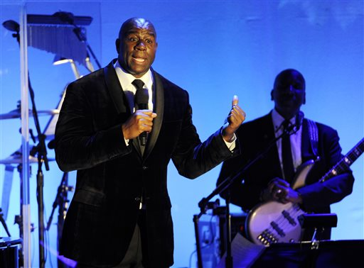 """In this Oct. 11, 2014, file photo, Earvin """"Magic"""" Johnson addresses the audience after receiving the Brass Ring Award for his humanitarian efforts at the 2014 Carousel of Hope Ball at the Beverly Hilton Hotel in Beverly Hills, Calif. The retired Los Angeles Laker became famous for dishing out assists to his teammates during his Hall of Fame basketball career. Now, as an entrepreneur focused on minority markets, he says he is ready to help Silicon Valley hire more blacks and Latinos to diversify the technology industry's largely white and Asian workforce. (Photo by Chris Pizzello/Invision/AP, File)"""