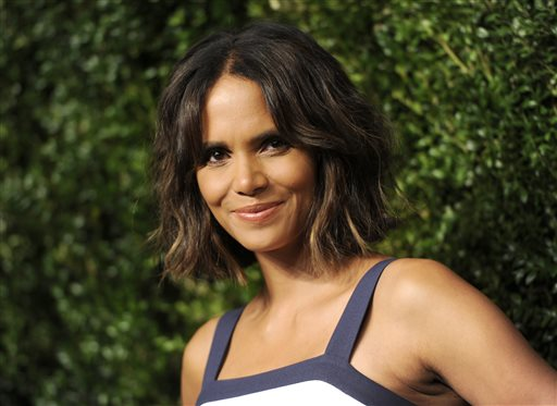 """FILE - In this Oct. 16, 2014 file photo, actress Halle Berry arrives at the God's Love We Deliver Golden Heart Awards in New York. The Oscar-winning actress is reviving Scandale Paris with a collection of 10 bras and panties to be sold by Target, and while """"rich with history and heritage,"""" they will boast """"a very good price,"""" said Berry. (Photo by Evan Agostini/Invision/AP, File)"""
