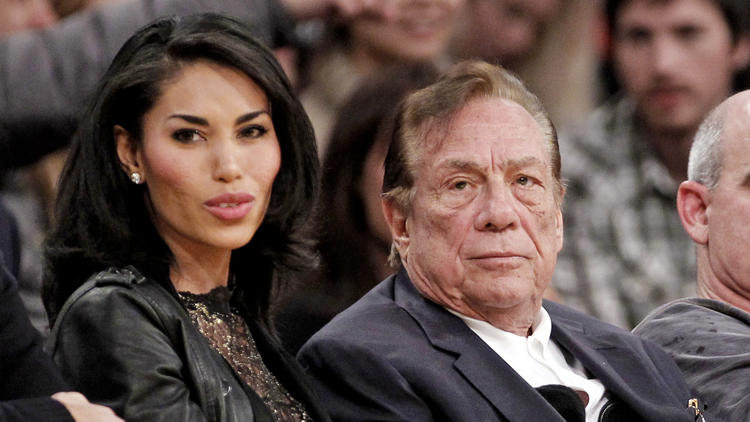 Donald Sterling and V. Stiviano watch a Clippers game together in 2010. (Danny Moloshok/AP)