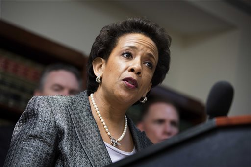 In this June 17, 2013 file photo, Loretta Lynch, United States Attorney for the Eastern District of New York, speaks during a news conference at the U.S. Attorney's office in the Brooklyn borough of New York. Lynch could be on a list of contenders to replace Eric Holder as Attorney General. If selected, Lynch would make history as the first black woman to lead the Justice Department. (AP Photo/John Minchillo, File)