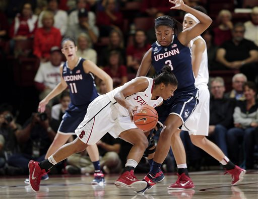 Stanford guard Amber Orrange, center, is defended by Connecticut forward Morgan Tuck (3) during the first half of an NCAA college basketball game on Monday, Nov. 17, 2014, in Stanford, Calif. (AP Photo/Marcio Jose Sanchez)