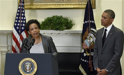 President Barack Obama listens as U.S. Attorney Loretta Lynch speaks after Obama nominated Lynch to be the Attorney General,Saturday, Nov. 8, 2014, in the Roosevelt Room of the White House in Washingto. Lynch would succeed Attorney General Eric Holder. (AP Photo/Susan Walsh)