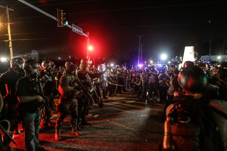 Protestors face off with police in Ferguson, Mo., after a grand jury decided not to indict Officer Darren Wilson. (Photo by Lawrence Bryant/St. Louis American)
