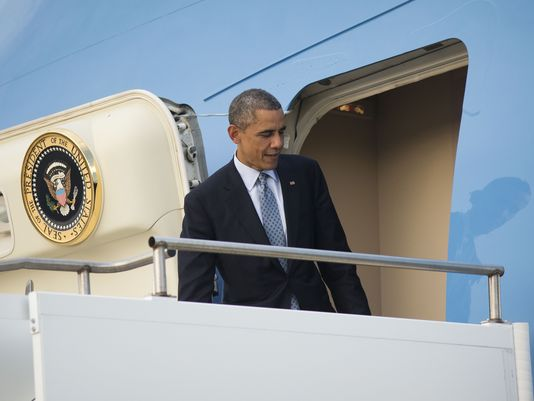 President Obama boards Air Force One on Nov. 16 after the Group of 20 summit in Australia. (Pablo Martinez Monsivais/ AP)