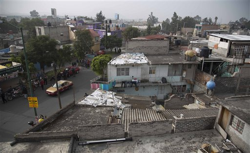 A view of one of several homes that police raided in their search for fugitive mayor of Iguala Jose Luis Abarca and his wife Maria de los Angeles Pineda in the Iztapalapa neighborhood of Mexico City, Monday, Nov. 4, 2014. Federal police detained the couple where they were hiding out in a house. They are accused of ordering the Sept. 26 attacks on teachers' college students that left six dead and 43 still missing. (AP Photo/Eduardo Verdugo)