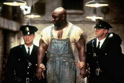 "In ""The Green Mile,"" Michael Clarke Duncan plays John Coffey, a death row inmate with healing powers."