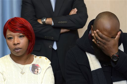 Lesley McSpadden, left, and Michael Brown, Sr., right, parents of teenager Michael Brown who was shot by a policeman in Ferguson, Missouri, speak during a press conference about the UN Committee Against Torture who convenes this week to evaluate the US government's compliance with the Convention Against Torture, in Geneva, Switzerland, Wednesday, Nov. 12, 2014. (AP Photo/Keystone, Martial Trezzini)