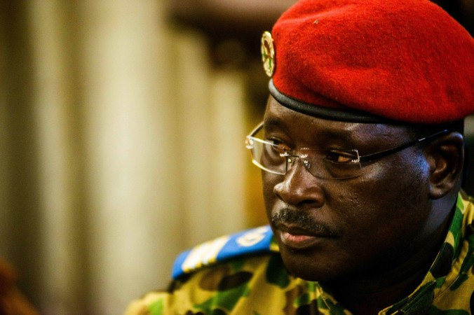 Burkina Faso Lt. Col. Issac Yacouba Zida pauses as he makes an announcement to the media in the city of Ouagadougou, Burkina Faso, Saturday, Nov. 1, 2014. Burkina Faso's former president fled to neighboring Ivory Coast with his family after violent protests drove him from power after 27 years in office, Ivory Coast said Saturday, as Zida, a largely unknown military colonel, said he had taken the helm. (AP Photo/Theo Renaut)