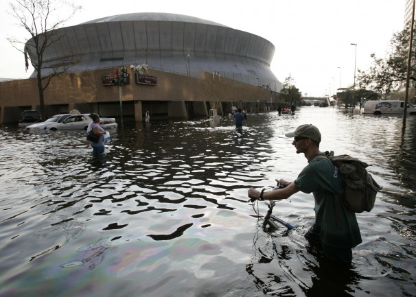 A man pushes his bicycle through flood waters near the Superdome in New Orleans on Aug. 31, 2005. (Eric Gay/AP Photo)