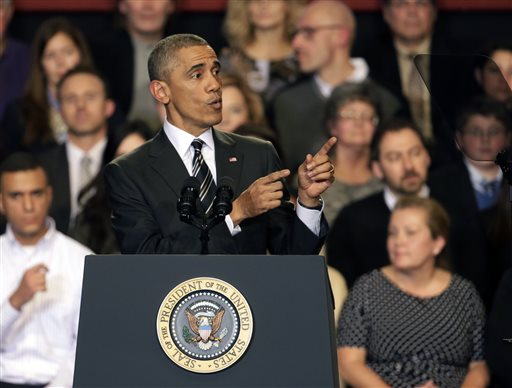 President Barack Obama tries to quiet one of three hecklers as he addresses the crowd after meeting with community leaders about the executive actions he is taking to fix the immigration system Tuesday, Nov. 25, 2014, in Chicago. (AP Photo/Charles Rex Arbogast)