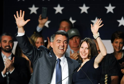 Senator-elect, U.S. Rep. Cory Gardner, (R-Colo.), left, celebrates with his wife Jamie Gardner, right, during the GOP election night gathering at the Hyatt Regency Denver Tech Center, in Denver, Colo., on Election Day, Tuesday Nov. 4, 2014. Gardner defeated incumbent Democratic Senator Mark Udall. (AP Photo/Chris Schneider)
