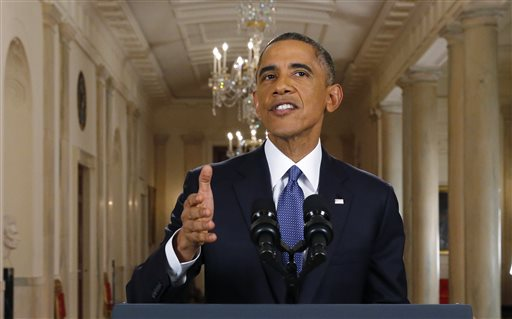 "President Barack Obama speaks during a nationally televised address from the White House in Washington, Thursday, Nov. 20, 2014. Spurning furious Republicans, President Barack Obama unveiled expansive executive actions on immigration Thursday night to spare nearly 5 million people in the U.S. illegally from deportation and refocus enforcement efforts on ""felons, not families.""  (AP Photo/Jim Bourg, Pool)"