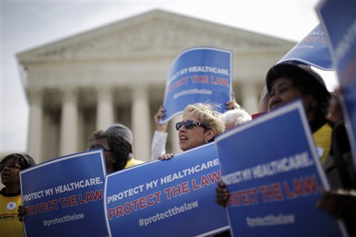 In this March 28, 2012 file photo, supporters of health care reform rally in front of the Supreme Court in Washington on the final day of arguments regarding the health care law signed by President Barack Obama. The Supreme Court agreed Friday to hear a new challenge to President Barack Obama's health care law. The justices said they will decide whether the law authorizes subsidies that help millions of low- and middle-income people afford their health insurance premiums.  (AP Photo/Charles Dharapak, File)