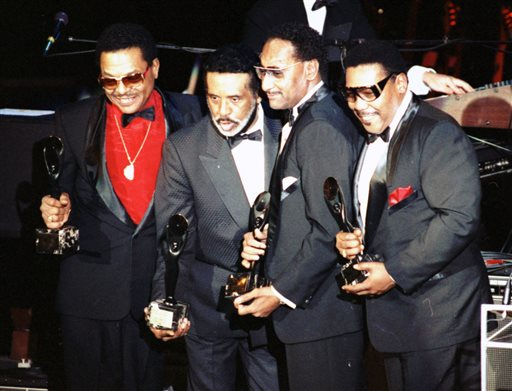 """In this Jan. 1990 file photo, the Four Tops, from left, Renaldo """"Obie"""" Benson; Levi Stubbs; Abdul """"Duke"""" Fakir, and Lawrence Payton in New York. Surviving members of The Four Tops and The Temptations will play the Palace Theatre together for seven shows between Dec. 29-Jan. 4. Tickets from $52-$142 go on sale Nov. 14. (AP Photo/Ron Frehm, File)"""