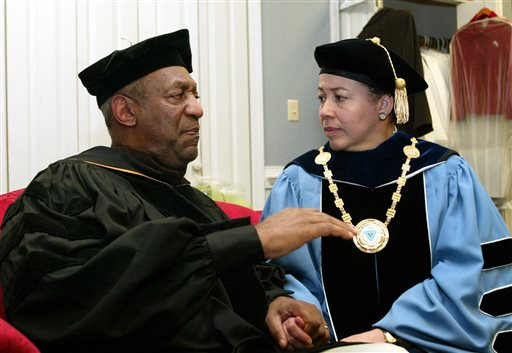 In this May 14, 2006 file photo, keynote speaker Bill Cosby, left, and Spelman College President Dr. Beverly Tatum talk before the start of commencement at the school in Atlanta. Cosby's legacy of giving is decades-old and extensive, topped by a $20 million gift to Spelman College in 1988 and including, among many other donations, $3 million to the Morehouse School of Medicine; $1 million in 2004 to the U.S. National Slavery Museum in Fredericksburg, Virginia; and $2 million from Cosby's wife, Camille, to St. Frances Academy in Baltimore in 2005. (AP Photo/W.A. Harewood, File)