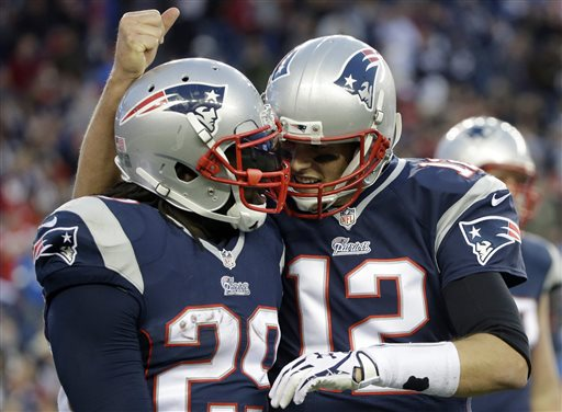 New England Patriots quarterback Tom Brady, right, congratulates running back LeGarrette Blount on his touchdown in the fourth quarter of an NFL football game against the Detroit Lions Sunday, Nov. 23, 2014, in Foxborough, Mass. The Patriots won 34-9. (AP Photo/Steven Senne)