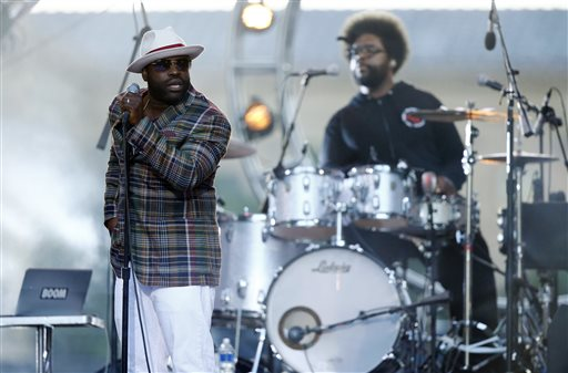 """In this July 4, 2014 file photo, Tariq """"Black Thought"""" Trotter, left, and Ahmir """"Questlove"""" Thompson of The Roots, perform during an Independence Day celebration in Philadelphia. The Roots are tapping into their resources to help raise funds for their high-school alma mater in Philadelphia. The Grammy-winning hip-hop band created the CAPA Foundation after learning that $1.1 million had been cut from the budget of the Philadelphia High School for Creative and Performing Arts. (AP Photo/Matt Rourke, File)"""