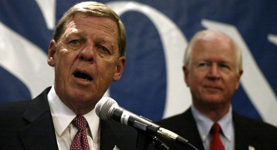 Senatorial candidate Rep. Johnny Isakson, R-Ga., speaks to supporters as Sen. Saxby Chambliss, R-Ga., right, looks on during an election night rally Tuesday, Nov. 2, 2004 in Atlanta. Isakson defeated Rep. Denise Majette, D-Ga., for the U.S. Senate. (AP Photo/John Bazemore)