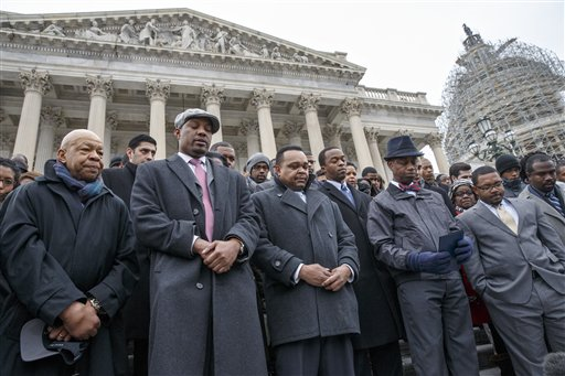 Congressional staff members, joined by Rep. Elijah Cummings, D-Md.,  left, gather on Capitol Hill in Washington, Thursday, Dec. 11, 2014, to raise awareness of the recent killings of black men by police officers, both of which did not result in grand jury indictments. The walkout came as both houses of Congress attempt to pass a spending measure and avert government shutdown.  (AP Photo/J. Scott Applewhite)