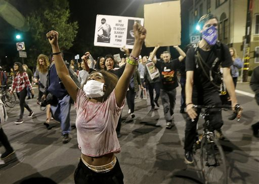 Protesters march in Berkeley, Calif., Monday, Dec. 8, 2014. in response to police killings in Missouri and New York. (AP Photo/Jeff Chiu)