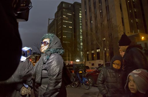 Leslie Pollard, left, speaks with reporters after a court hearing for her son Ackquille Pollard, also known as Bobby Shmurda, Thursday Dec. 18, 2014, in New York.  A judge has set bail at $2 million for the Brooklyn rapper Shmurda, 20, on gun and narcotic charges. Pollard says she expects her son will make bail and prove his innocence. (AP Photo/Bebeto Matthews)
