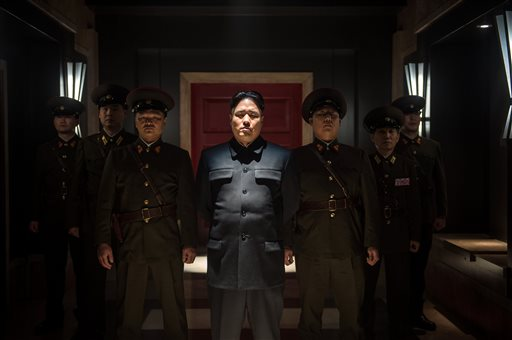 """This photo provided by Columbia Pictures - Sony shows, Randall Park, center, as North Korean leader Kim Jong Un in Columbia Pictures' """"The Interview."""" North Korea has been linked to the unprecedented act of cyberwarfare against Sony Pictures that exposed tens of thousands of sensitive documents and escalated to threats of terrorist attacks that ultimately drove the studio to cancel all release plans for """"The Interview."""" (AP Photo/Columbia Pictures - Sony, Ed Araquel)"""