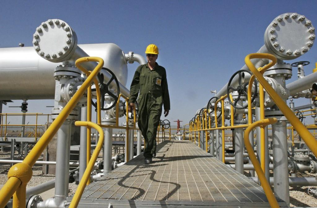 An oil technician in an oil field southwest of Tehran. (AP Photo)