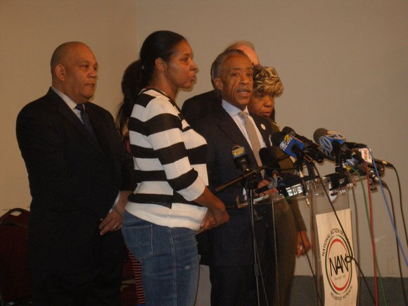 The Rev. Al Sharpton and the family of Eric Garner at the National Action Network.(Herb Boyd/New York Amsterdam News)