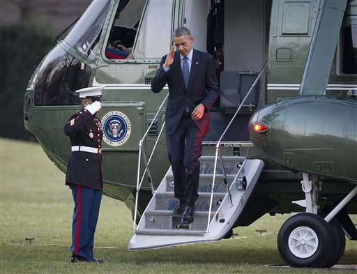 President Barack Obama returns a salute as he steps off Marine One helicopter upon his return on the South Lawn of the White House in Washington, Monday, Dec. 15, 2014. Obama traveled to New Jersey to speak to members of the military at Joint Base McGuire-Dix-Lakehurst. (AP Photo/Pablo Martinez Monsivais)
