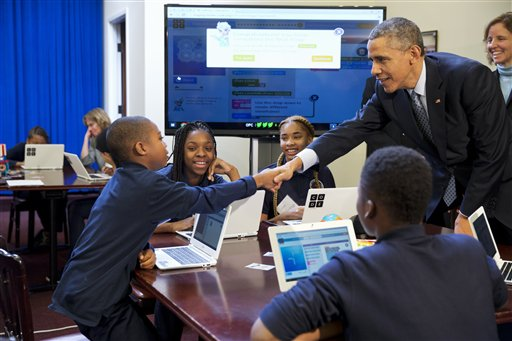 "President Barack Obama greets students during an ""Hour of Code"" event in the Eisenhower Executive Office Building on the White House complex in Washington, Monday, Dec. 8, 2014, attended by middle-school students from Newark, N.J. (AP Photo/Jacquelyn Martin)"
