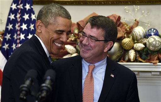 President Barack Obama shares a laugh with Ashton Carter, his nominee for defense secretary, Friday, Dec. 5, 2014, during the announcement in the Roosevelt Room of the White House in Washington.  (AP Photo/Susan Walsh)