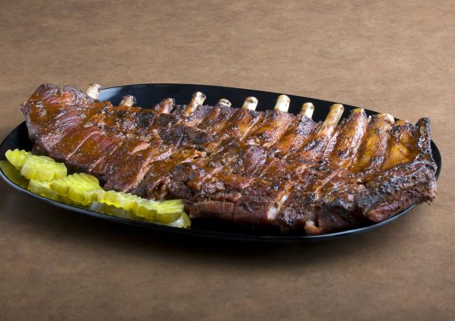 A plate of barbecue ribs is seen at Gates Bar-B-Q in Kansas City, Mo., Friday, May 2, 2008. (AP Photo/Chuck France)