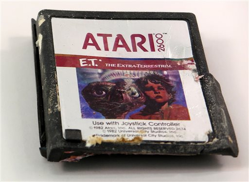 This undated photo provided by the Smithsonian's National Museum of American History shows one of the decades-old Atari 'E.T. the Extra-Terrestrial' game that was found in a dumpsite in Alamogordo, N.M. The Atari game cartridge unearthed earlier this year along with about 800 other Atari games, some ET and some others from a heap of garbage buried deep in the New Mexico desert has been added to the video game history collection at the Smithsonian. Museum specialist Drew Robarge made the announcement Monday, Dec. 15, 2014 in a blog post. (AP Photo/Smithsonian's National Museum of American History)