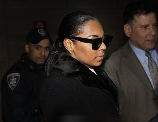 """Singer Ashanti leaves the courthouse after testifying at Devar Hurd's trial in New York, Tuesday, Dec. 16, 2014. Ashanti said in testimony that she was """"disgusted"""" and """"absolutely scared"""" when she learned in July 2013 that Hurd, who had been convicted of stalking her, had since been tweeting her X-rated messages and posed for a photo with her sister. (AP Photo/Seth Wenig)"""