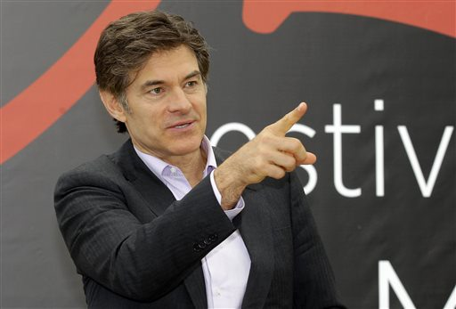 This June 13, 2012 file photo shows television personality Dr. Mehmet Oz during a photocall at the 2012 Monte Carlo Television Festival in Monaco. On Tuesday, Aug. 20, 2013, Oz rushed to an accident scene after a yellow cab jumped the curb and struck a pedestrian outside New York's  Rockefeller Center. Oz says in a statement that emergency medical crews were already treating the injured woman who had a bad leg wound. He says a good Samaritan made a tourniquet out of a belt for the woman. (AP Photo/Lionel Cironneau, File)