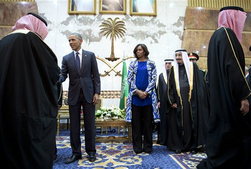 President Barack Obama and first lady Michelle Obama participate in a delegation receiving line with new Saudi Arabian King, Salman bin Abdul Aziz, fith left, in Riyadh, Saudi Arabia, Tuesday, Jan. 27, 2015. The president and first lady have come to expresses their condolences on the death of the late Saudi Arabian King Abdullah bin Abdulaziz al-Saud. (AP Photo/Carolyn Kaster)