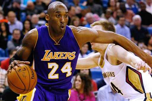 Los Angeles Lakers guard Kobe Bryant (24) drives against New Orleans Pelicans guard Nate Wolters, right, during the first half of an NBA basketball game, Wednesday, Jan. 21, 2015, in New Orleans. (AP Photo/Jonathan Bachman)