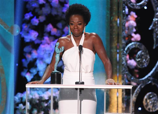 "Viola Davis accepts the award for outstanding performance by a female actor in a drama series for ""How to Get Away with Murder"" on stage at the 21st annual Screen Actors Guild Awards at the Shrine Auditorium on Sunday, Jan. 25, 2015, in Los Angeles. (Photo by Vince Bucci/Invision/AP)"