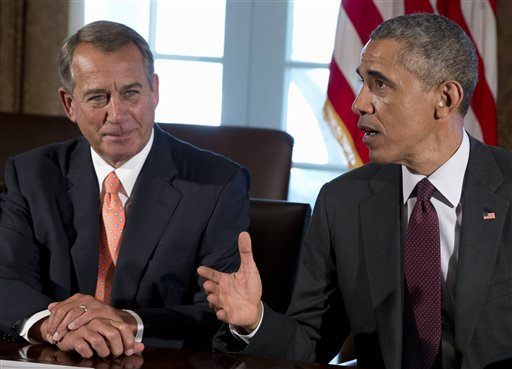 In this Jan. 13. 2015 file photo, House Speaker John Boehner of Ohio listens at left as President Barack Obama speaks to media as he meets with bipartisan, bicameral leadership of Congress to discuss a wide range of issues, in the Cabinet Room of the White House in Washington. President Barack Obama has vetoed just two measures in his six years in the White House, the fewest by any U.S. president since the 1880s. But since the Republicans have assumed control of both houses of Congress this month for the first time in his presidency, Obama has threatened to veto five more.  (AP Photo/Carolyn Kaster, File)
