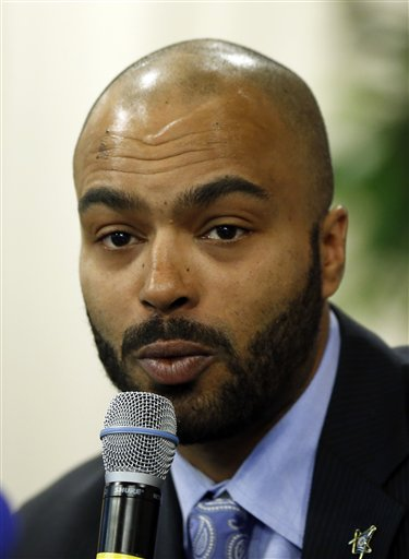 In this March 19, 2014 file photo, Christopher Barry, the son of the late former mayor and DC City Council member Marion Barry, speaks in Washington. The only son of Barry is seeking his late father's seat on the D.C. Council. Thirty-four-year-old Christopher Barry picked up nominating petitions at the D.C. Board of Elections on Monday. (AP Photo/Alex Brandon, File)