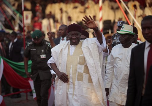 Nigerian President Goodluck Jonathan waves at supporters in Yola, Nigeria, Thursday, Jan. 29, 2015. Youths angry at the Nigerian government's failure to fight Islamic extremists threw stones Thursday at President Goodluck Jonathan's electioneering convoy in the eastern town of Jalingo, breaking windshields and windows on several vehicles. (AP Photo/Lekan Oyekanmi)