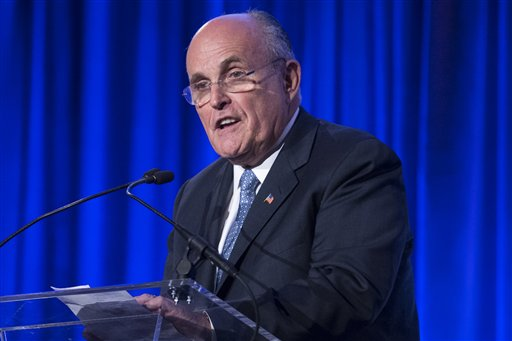 "In this May 12, 2014 file photo, former New York City Mayor Rudy Giuliani speaks in New York. Democrats on Thursday assailed Giuliani for questioning President Barack Obama's love of country, and urged the potential field of Republican presidential candidates to rebuke his comments. Democratic National Committee chair Debbie Wasserman Schultz said at the start of the DNC's winter meeting that now is the time for Republican leaders to ""stop this nonsense."" (AP Photo/John Minchillo, File)"