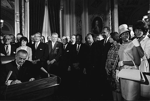 President Lyndon B. Johnson signs the Voting Rights Act of 1965 into law. (Yoichi R. Okamoto)