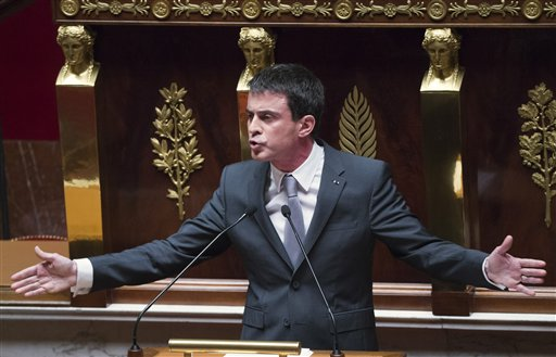 French Prime Minister Manuel Valls gestures as he speaks prior to a parliamentary vote of confidence over the government's economic reform at the French National Assembly, Paris, Thursday, Feb 19, 2015. Valls faced a parliamentary showdown Thursday with the fate of his government in the balance — as rebels within his own Socialist Party teamed up with conservatives to demand he scrap pro-business policies he rammed through Parliament without a vote. (AP Photo/Jacques Brrinon)