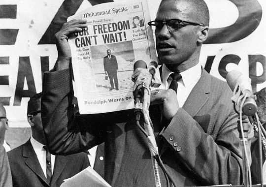 Black Muslim leader Malcolm X holds up a paper for the crowd to see during a Black Muslim rally in New York City on Aug. 6, 1963. (AP Photo)