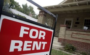 """In this Sept. 24, 2007 file photo, a """"for rent"""" sign is posted outside a home in Denver.  Real estate data firm Zillow reports on U.S. home rental prices in January 2015 on Friday, Feb. 20, 2015. (AP Photo/David Zalubowski, File)"""